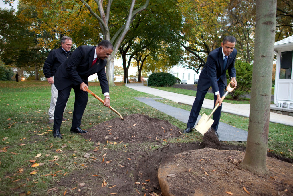 President Barack Obama, along with Grounds Superintendent Dale Haney and Chief Usher Rear Admiral Stephen W. Rochon (Ret.), participates in a commemorative tree planting ceremony on the North Grounds of the White House, Oct 28, 2009. (Official White House Photo by Chuck Kennedy) This official White House photograph is being made available only for publication by news organizations and/or for personal use printing by the subject(s) of the photograph. The photograph may not be manipulated in any way and may not be used in commercial or political materials, advertisements, emails, products, promotions that in any way suggests approval or endorsement of the President, the First Family, or the White House.