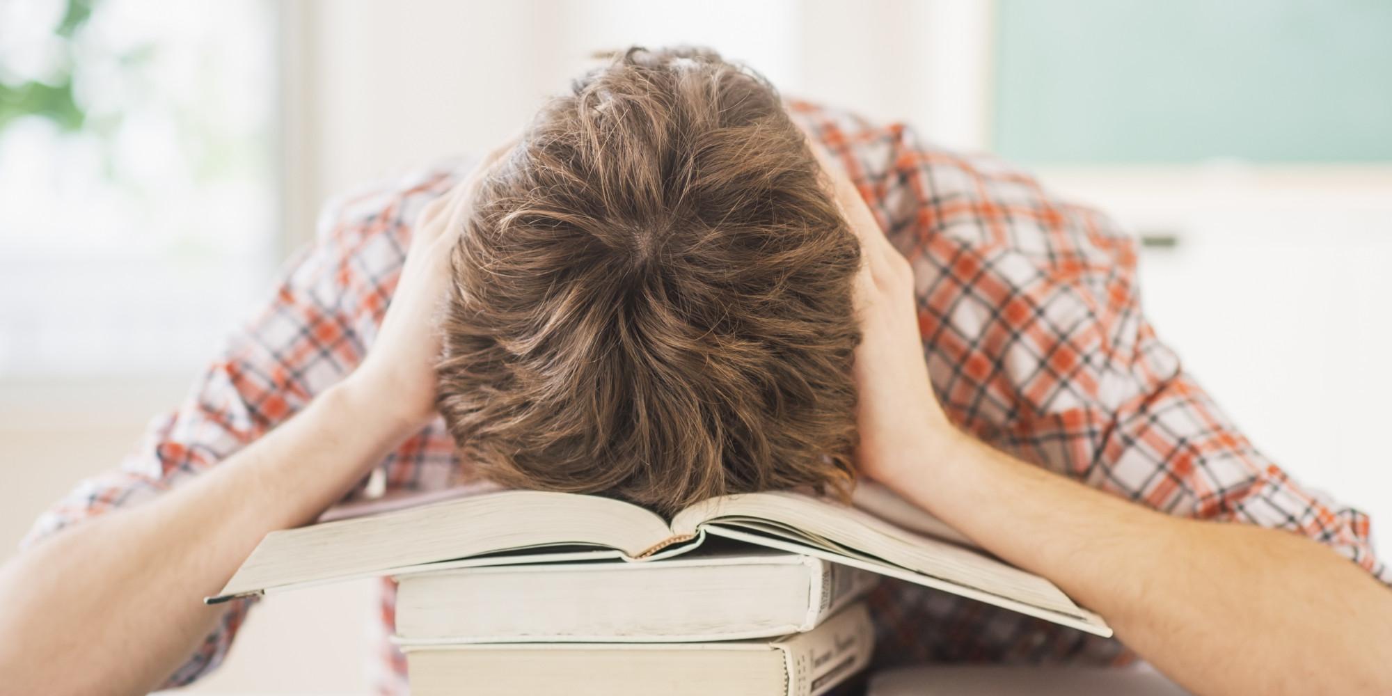 USA, New Jersey, Jersey City, Teenage boy (14-15) sleeping in classroom